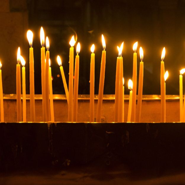 lite-candles-in-church-of-the-holy-high-res-stock-photography-955156434-1550496599